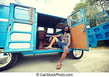 smiling young hippie man in minivan car - nature, summer,...