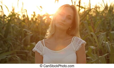 Portrait of Pretty Woman at Sunset