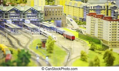 train stand on rail on platfom in modern toy city. image is  washed away