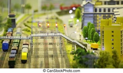 in small model sity trian arrives to wayside station and...