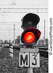 red semaphore signal on railway in spring time - red...