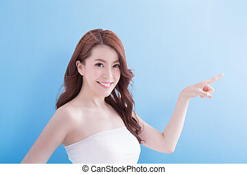 Beauty woman with charming smile and show something to you...