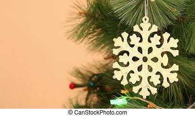 Christmas ornaments snowflake hanging on a branch Background...