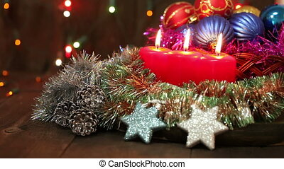 Burning candles and Christmas decorations.