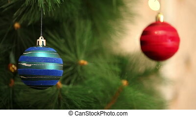 A bunch of blue balls on the Christmas tree.