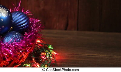 Blue balls in a wicker basket and garland flashing Christmas...