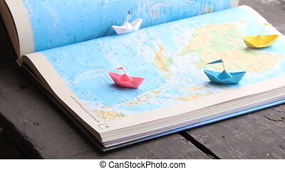 travel, tour or tourism idea, paper boats and map - Travel...