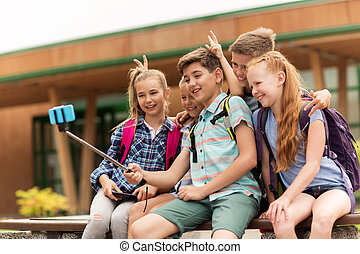 happy elementary school students taking selfie - primary...