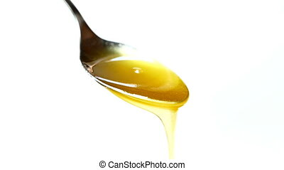 honey dripping on a spoon close-up