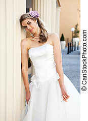 Young Bride Leaning Against a Pillar