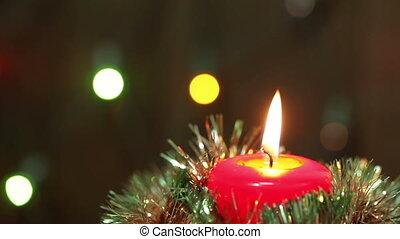 Burning Christmas candle Flashing blurred background...