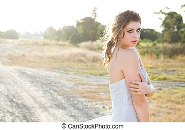 Attractive Young Woman in a Rural Landscape