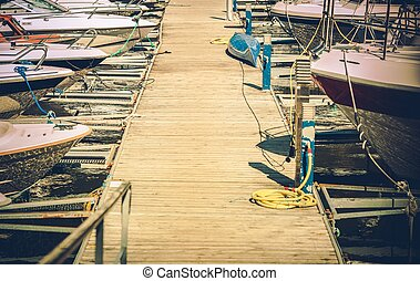Small Motorboats Marina with Straignht Wooden Deck Alley....