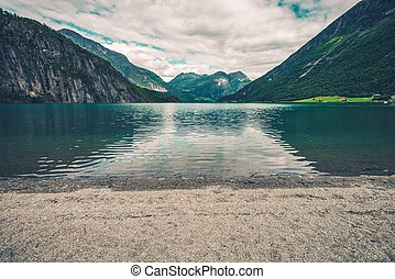 Glacial Lake Beach in Norway. Scenic Lake Place Near Stryn,...