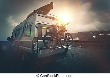 The Ultimate Camper Camping. Modern Camper with Bike on a...