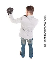businessman with boxing gloves in fighting stance backside...