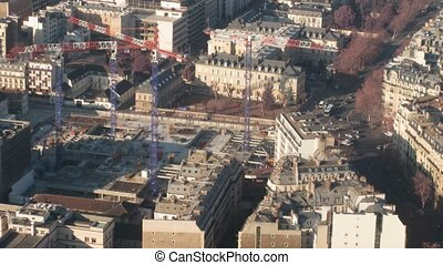 Cranes on a building site in the center of Paris, France, the top view. Time lapse.