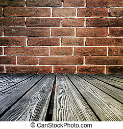 Rostrum made of wooden planks on brick wall background