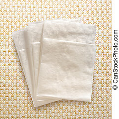 White paper napkins on the textile background