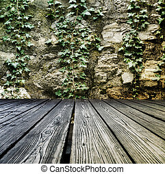 Rostrum made of wooden planks on stone wall background