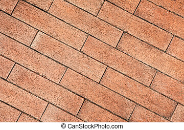 Red brick wall in closeup as background