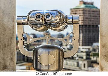 Touristic monocular for panorama city view closeup
