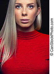 Close-up portrait of a blonde woman in red dress - Fashion...