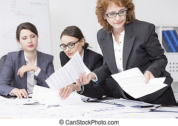Trying to find some crucial papers - Middle-aged corporate...