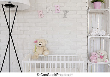 Gentleness close to your baby - Teddy bear sitting on a baby...