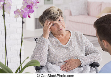 Today i don't feel good - Senior woman on a wheelchair with...