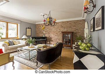 Creative stylish living room with trendy red brick wall