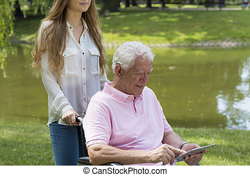 Senior getting along with technology - Elderly man on a...