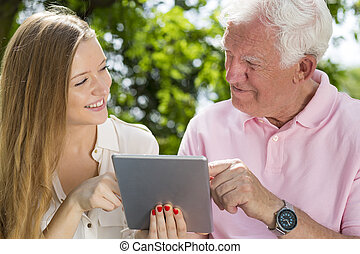 Could you show me how to use it? - Young carer and senior...