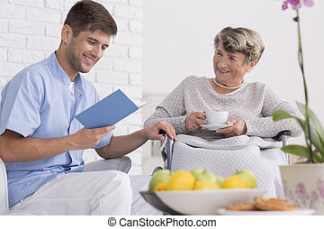 Could you read me something? - Carer reading a book to a...