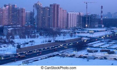 Modern city and movement on high-speed highway nearby. Moscow, Russia. Time Lapse.