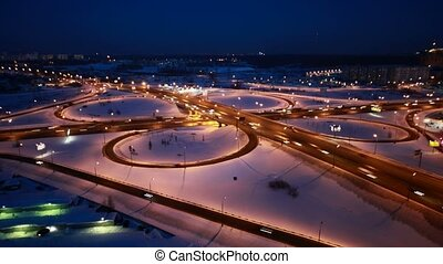Brisk movement on modern highway in the night. Moscow, Russia. Time Lapse.