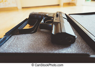 Semi-automatic pistol - Closeup of a semi-automatic pistol...