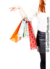 Shopaholic - Womans hand holding shopping bags - isolated on...