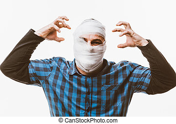 Human reactions - Portrait of a desperate man with bandaged...