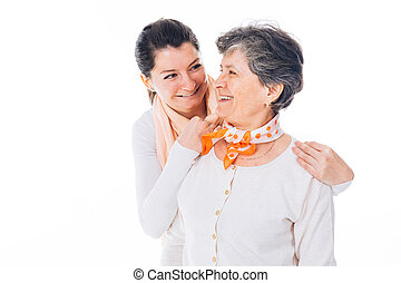 Senior mother and adult daughter laughing