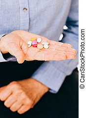 Unknown person holding pills - Suicidal intentions of a...