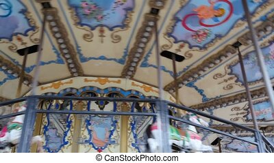 carousel merry-go-round amusement with horses rotating...