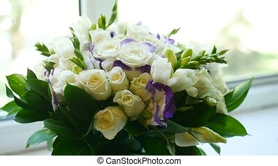 small bouquet of white roses on the video window