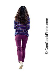 back view of walking curly woman - back view of walking...