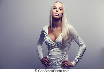 Fashion portrait of a blonde woman in with attitude -...