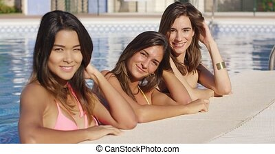 Three attractive women enjoying a summer vacation together...