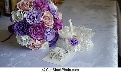 bridal bouquet of blue, purple and white roses on a video table