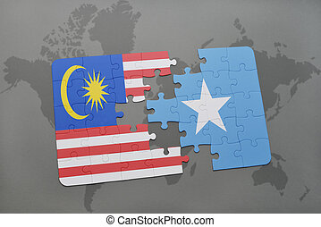 puzzle with the national flag of malaysia and somalia on a...
