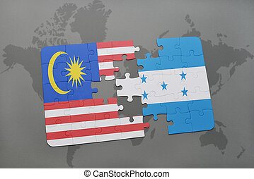 puzzle with the national flag of malaysia and honduras on a...
