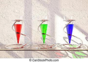 Three glass vessels with liquid - Three glass vessels with...